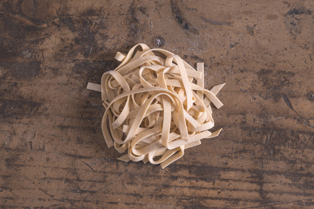 Hand made tagliatelle typical fresh pasta from Emilia-Romagna