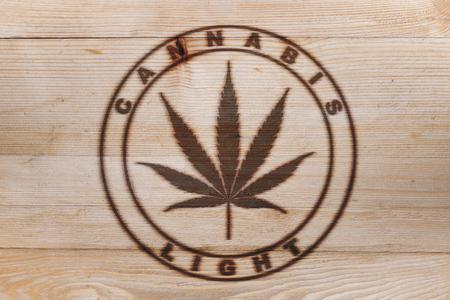 Cannabis weed cannabis light fire branded logo on wood board