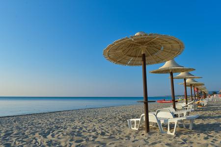Morning beach resort with bamboo umbrella in south italian beach