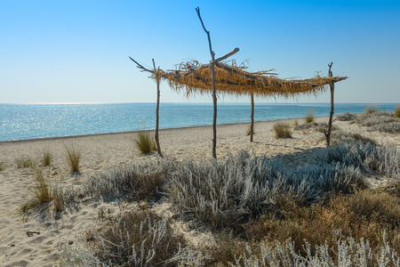 Bamboo beach gazebo on desert beach in south italy