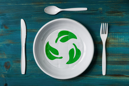 top view of a recyclable plastic dish with environmental green logo