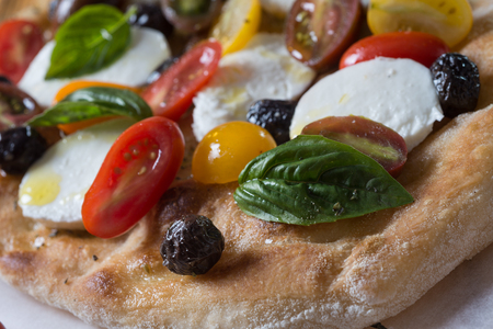 On shovel colored romana pizza on still life food composition