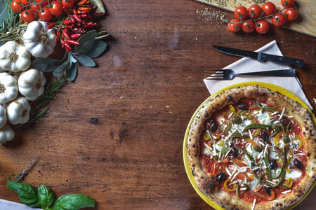 Top view backgound italian Napolitan pizza with peppers, olives, tomatoes and cheese. frame composition with ingredients free space for text Stock Photo