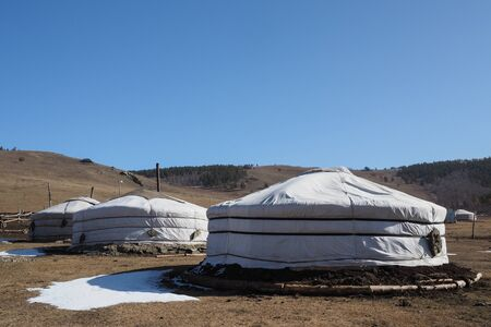 Traditional Mongolian Yurta in Orkhon province mountains landscape