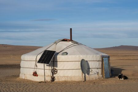 Traditional Mongolian Yurt with tecnlogic facilities, satellite antenna and solar panel Imagens