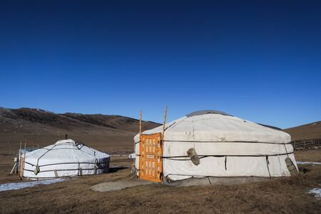 Traditional Mongolian Yurta in Orkhon region mountains landscape
