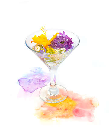 Orange and purple violet flowers float in martini glass with hand painted watercolor blot on white background. Design element, decor of authors cocktails with floral notes, wedding cards, recipes.