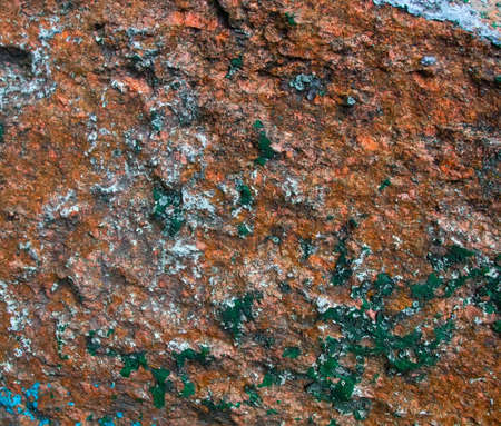 Old painted granite stone rock background. In brown, blue, yellow, orange and green colors Foto de archivo