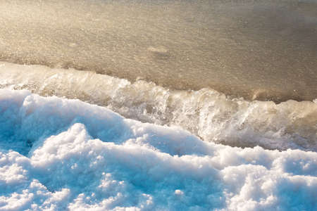 Ice sea water waves and snow abstract background photo