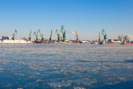Industrial Klaipeda city and sea port view from the water in frosty winter sunny day. 版權商用圖片