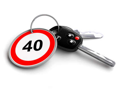 keyring: Car keys with speed limit traffic sign as keyring - concept for cars speeding Stock Photo
