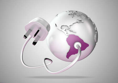 An electricity cable and plug connects to South America on world globe. Concept for power and electricity usage in South America. photo