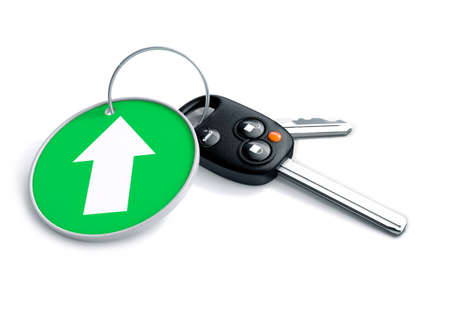 keyring: Set of car keys and keyring isolated on white with arrow on green background pointing upwards. Concept for growth of car sales or vehicle manufacturing industries. Stock Photo