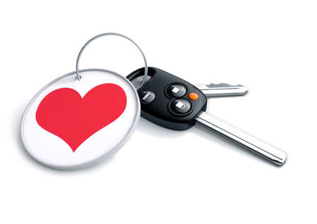 keyring: Set of car keys with keyring and red heart icon. Concept for how people love the car they drive and become emotionally attached and fanatical over their vehicle.