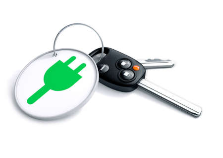 plug electric: Set of car keys with keyring and electric power icon on it. Concept for converting consumers to using electric powered vehicles and cars in the future. Stock Photo