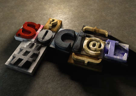 mass media: Wooden printing blocks form word Social. Concept for social media and how far mass communication has come since the day of the printing press. Stock Photo