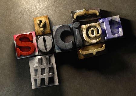 """imprenta: Bloques de impresión de madera forman la palabra """"social"""". Concepto para las redes sociales y en qué medida la masa de comunicación ha llegado desde el día de la imprenta. Foto de archivo"""