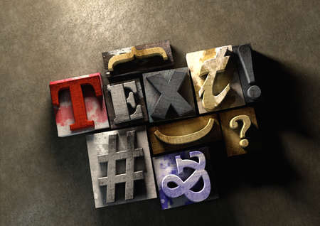 Wooden printing blocks form word Text. Graphic look at type and typography by using the old wooden printing press blocks.