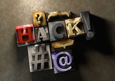 Colorful, grunge textured wooden printing blocks packed together to form the word hack. Concept for hacking or stealing code, passwords and data.