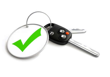 key ring: Car keys with approved tick symbol on key ring. Concept for approved vehicle finance loan or sale. Stock Photo