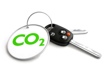 zero emission: Car keys with co2 carbon emissions symbol on key ring. Concept for how cars emit carbon dioxide into the atmosphere and the need for clean green electric energy for vehicles.