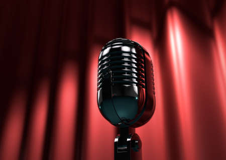 Vintage microphone on stage with red curtains. Moody stage lighting creates drama and suspense.
