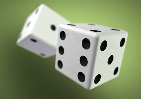 Two die dice captured rolling in mid air while being thrown in casino, board game or gambling. Taking a chance on a bet. Stock Photo