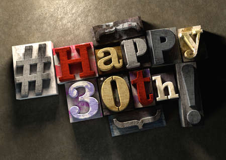 30th: Ink splattered printing wood blocks with grungy Happy 30th birthday typography. Social media hashtag gives a modern edgy graphic design feel. Trendy happy birthday title, for use on birthday card. Stock Photo