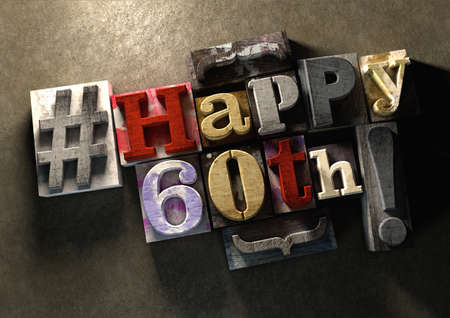 adult birthday party: Ink splattered printing wood blocks with grungy Happy 60th birthday typography. Social media hashtag gives a modern edgy graphic design feel. Trendy happy birthday title, for use on birthday card.