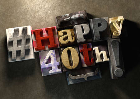 40: Ink splattered printing wood blocks with grungy Happy 40th birthday typography. Social media hashtag gives a modern edgy graphic design feel. Trendy happy birthday title, for use on birthday card.