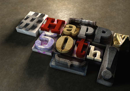 Ink splattered printing wood blocks with grungy Happy 50th birthday typography. Social media hashtag gives a modern edgy graphic design feel. Young and trendy happy birthday title, for use on a best wishes birthday card. Stock Photo