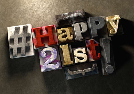 Ink splattered printing wood blocks with grungy Happy 21st birthday typography. Social media hashtag gives a modern edgy graphic design feel. Young and trendy happy birthday title, for use on a best wishes birthday card. Stock Photo