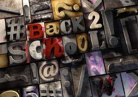 education message - Back to School! Grungy typography on textured wooden printing blocks using text characters and symbols to create a funky colorful baakground. End of the holidays and back to studying and working hard at school and college.
