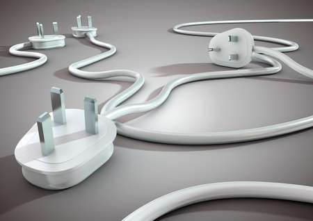 Power plugs lying on bright colored floor unplugged, concept for energy and electricity conservation.
