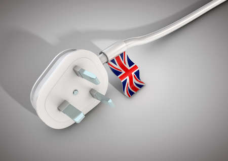 Electrical power cable and plug with British country flag attached. Concept for electrical power usage in the United Kingdom Stock Photo