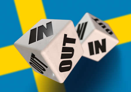 In or Out vote on dice for concept of Sweden leaving the European Union with Swedish flag in the background. Concept for citizens voting for independence and exiting the EU. Swexit. Stock Photo