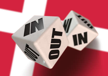 In or Out vote on dice for concept of Denmark leaving the European Union with Danish flag in the background. Concept for citizens voting for independence and exiting the EU. Dexit. Stock Photo