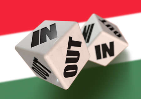 yes or no to euro: In or Out vote on dice for concept of Hungary leaving the European Union with Hungarian flag in the background. Concept for citizens voting for independence and exiting the EU. Hexit.