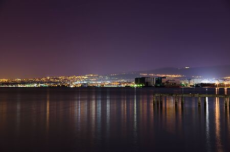 Thessaloniki reflecting her lights on the sea. Greece