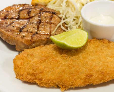 breaded: Breaded fish steak with steak or pork