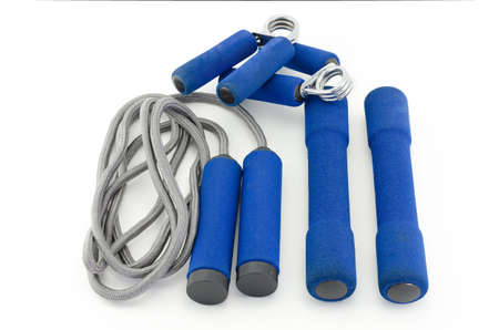 hand grip: skipping rope ,Sport hand grip and Dumbbells with soft shell equipment isolated on white Stock Photo