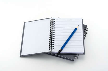 Blue pencil and notebook isolated on a white background