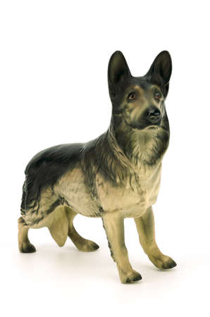 statuette: statuette of dog  isolated on white background,german shepherd
