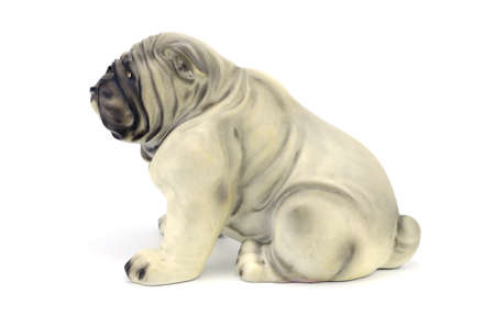 statuette: Statuette of dog  isolated on white background with clipping path