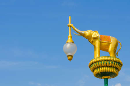 The architecture golden elephant statue on blue sky Stock Photo
