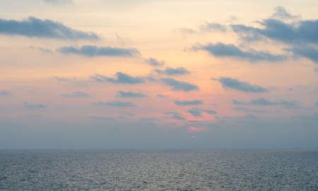 Sunset in the sea,Orange sunset sky,Sunset Sky Background Фото со стока