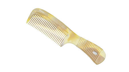 Brown plastic comb isolated on white background with clipping path Фото со стока