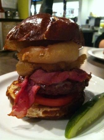 Custom burger creation with pastrami onion rings big patty