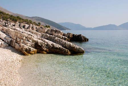 poros: A tiny empty beach in the village of Poros