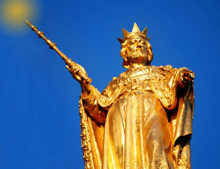 Golden statue appears to cast spell Stock Photo